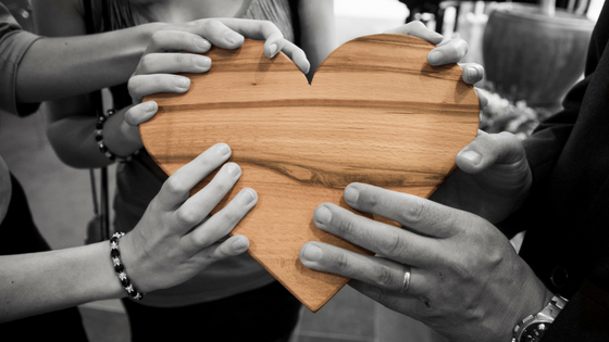 Hands on wooden heart