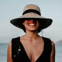 Woman with hat smiling